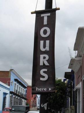 Storefront Tour Operator Promoting Bus Tours - Alvin Starkman