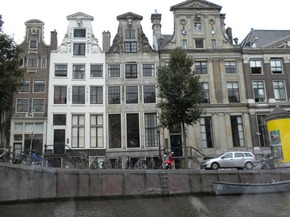 Façades in Amsterdam, seen from a canal