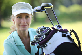 Lady golfer with clubs