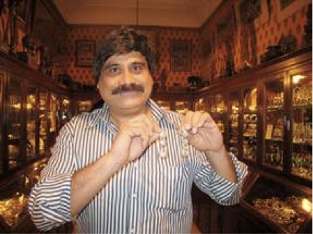 Sanjay, owner of Gem Palace