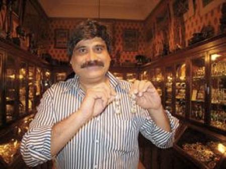 Sanjay, owner of Gem Palace