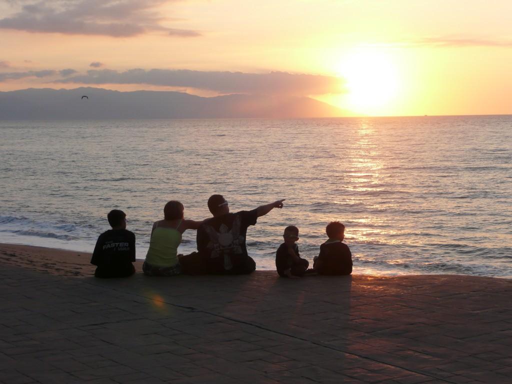 Family enjoying the sunset on Banderas Bay