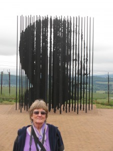 The author poses in front of the amazing sculpture of Nelson Mandela's face
